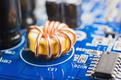 Coil on a motherboard Stock Photo