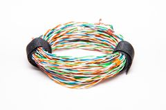 Coil of multicolored wires. Striped networking cables, twisted pair. Orange blue, green, brown color.  on white background Royalty Free Stock Photos