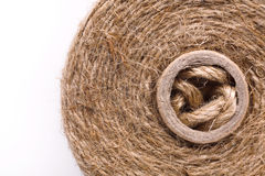 Coil of natural rope on white background Royalty Free Stock Photos
