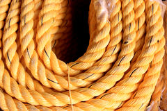 Coil of nylon rope. Closeup view of rope bundle. Photo of Coil of yellow nylon rope Stock Images