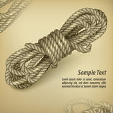 Coil of rope on rown & text Stock Image