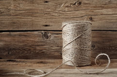 Coil of rope twine on a wooden background closeup Stock Image
