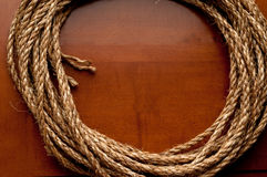 Coil of rope on a wooden surface Royalty Free Stock Photo