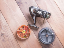 Coil, spools of fishing line, and yellow box for hooks Stock Photography
