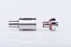 Coil and tank. Disassembled e-cig atomizer on the white background stock images