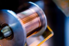 Coil with thick copper wire, welding machine element. Close-up photo Royalty Free Stock Image