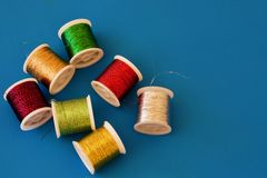Coil of thread. Colourful coil of thread on the white table Royalty Free Stock Photography