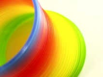 Coil toy. Rainbow colored plastic spring toy Stock Photo