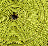 Coil of Webbing. Tightly wound makes colorful pattern off center royalty free stock photo