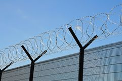 Coiled barbed wire security fence. Stock Photo