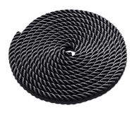 Coiled black rope Stock Images