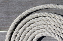 Coiled boat mooring rope Stock Image