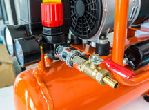 Coiled Compressed in air compressor. Coiled Compressed in orange air compressor stock photography