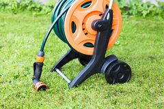 Coiled garden hose on reel Royalty Free Stock Images