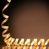 Coiled gold ribbon Christmas border Royalty Free Stock Photo