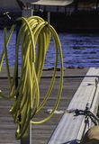 Coiled hosepipe on a jetty Stock Photos