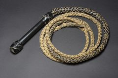 Bullwhip with black leather handle Royalty Free Stock Photos