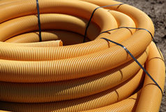 Coiled plastic tubing. Close up of orange, coiled plastic tubing material Royalty Free Stock Photography