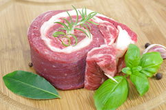 Coiled raw beef with basil. On cutting board Stock Photography