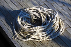 Coiled rope. On a boat jetty in Camden, Maine Royalty Free Stock Images