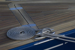 Coiled rope on the deck. Stock Photography