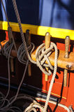 Coiled rope lines. Stored on belaying pins  on a wooden tall ship Stock Images
