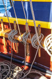 Coiled rope lines. Stored on belaying pins  on a wooden tall ship Royalty Free Stock Photo