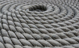 Coiled Rope Macro. A close shot of a coiled rope on the deck of a sailing vessel (tall ship Stock Photos