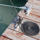 Coiled rope. Neatly coiled rope leading to the cleat Royalty Free Stock Photo