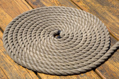 A coiled rope on a pier background Royalty Free Stock Images