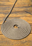 Coiled rope on a pier background Royalty Free Stock Image