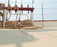 Coiled rope rigging on a sailboat deck. Stock Photos