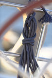 Coiled rope on sailboat. Details of a coiled rope on a sailboat Royalty Free Stock Image
