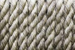 Coiled rope. Strong old rough coiled dirty rope Stock Images
