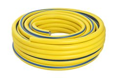 Coiled rubber garden hose isolated. A new yellow coiled rubber garden hose isolated on white background stock photography