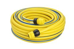 Coiled rubber garden hose isolated. Yellow coiled rubber garden hose with quick-connector system isolated on white background royalty free stock image
