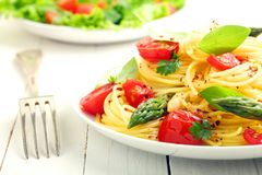 Coiled spaghetti with tomato and basil Stock Image