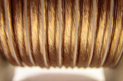 Coiled Speaker Wire. Closeup of golden coiled speaker wire - abstract concept stock photography