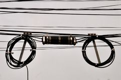 Coiled telephone wires and junction box royalty free stock images
