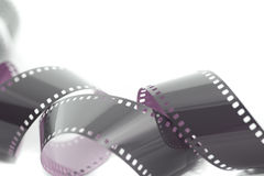 Coiled unrolled exposed 35mm film strip Royalty Free Stock Photo