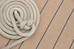 Coiled up rope on a ship's deck Royalty Free Stock Photo