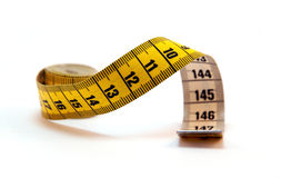 Coiled yellow Tape Measure isolated Stock Photos