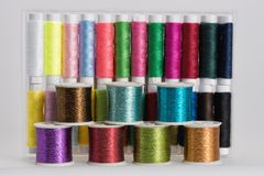 Coils with color threads. 24 various colors Stock Photos