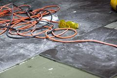 Coils of electrical cable lying on floor workplace Stock Images