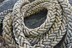 Coils of hemp rope on a beach Stock Photo