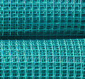 Coils with mesh for fencing. Stock Images