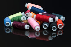 Coils with multi-colored sewing threads Stock Images