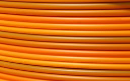 Coils of orange plastic pipes for the installation of undergroun Royalty Free Stock Photo