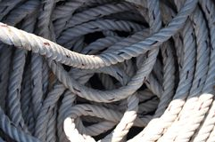 Coils of rope. Coils of white synthethic mooring line stock photos