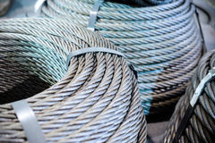 Coils of steel cable. Several steel wire rope rings stacked on the floor Stock Images